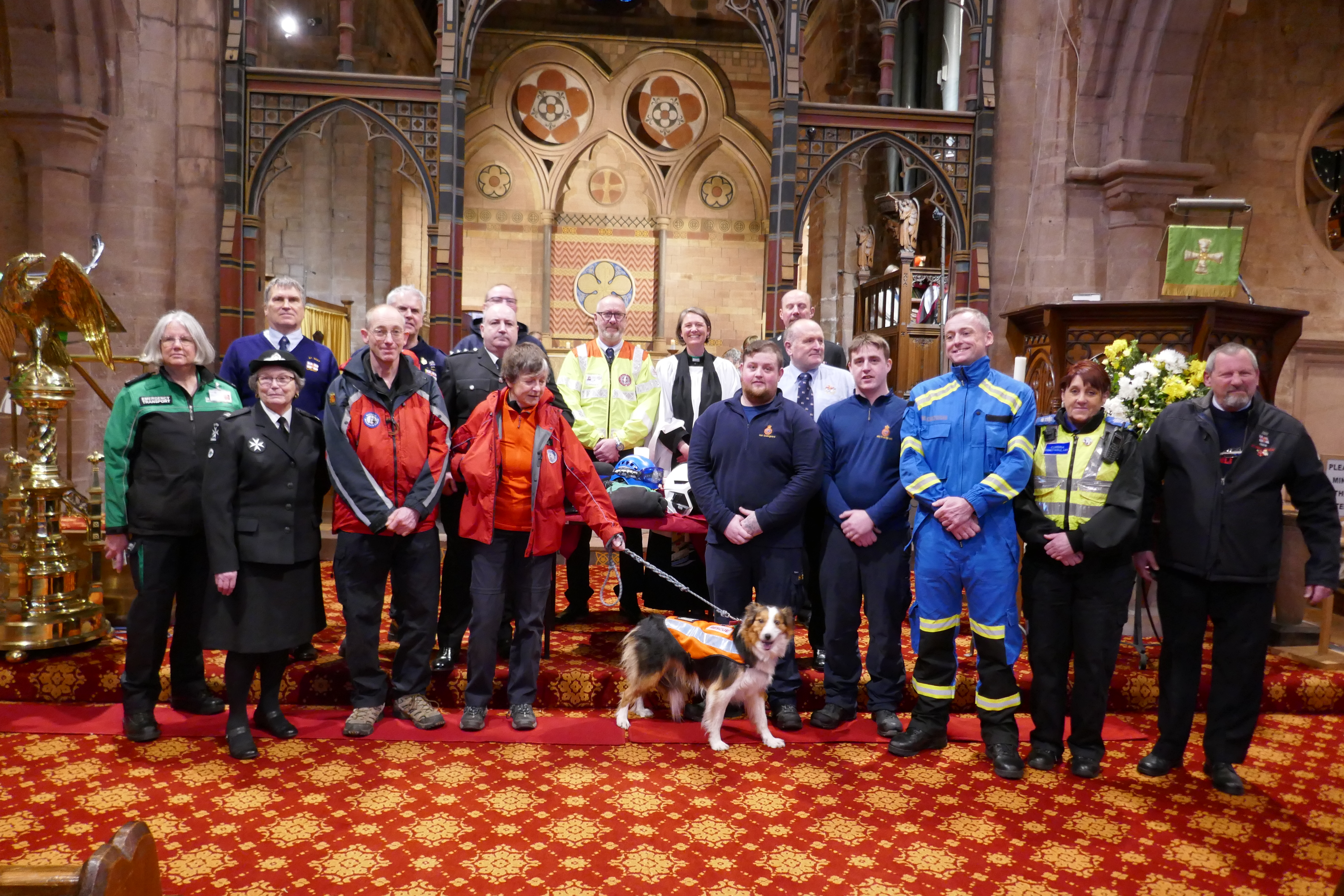 Members of Copeland's emergency services gather for a team photo at the end of the thanksgiving service.