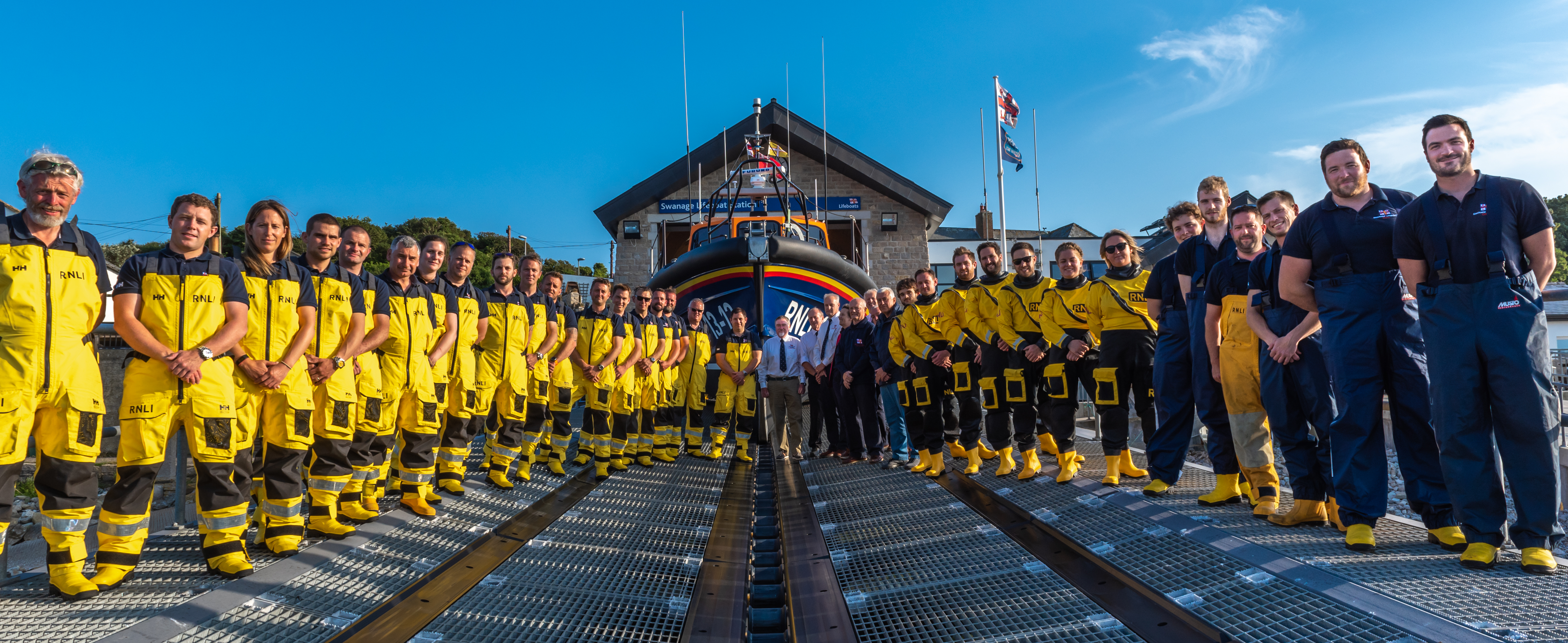 Swanage lifeboat crew on the slipway in front of the all-weather lifeboat, the George Thomas Lacy