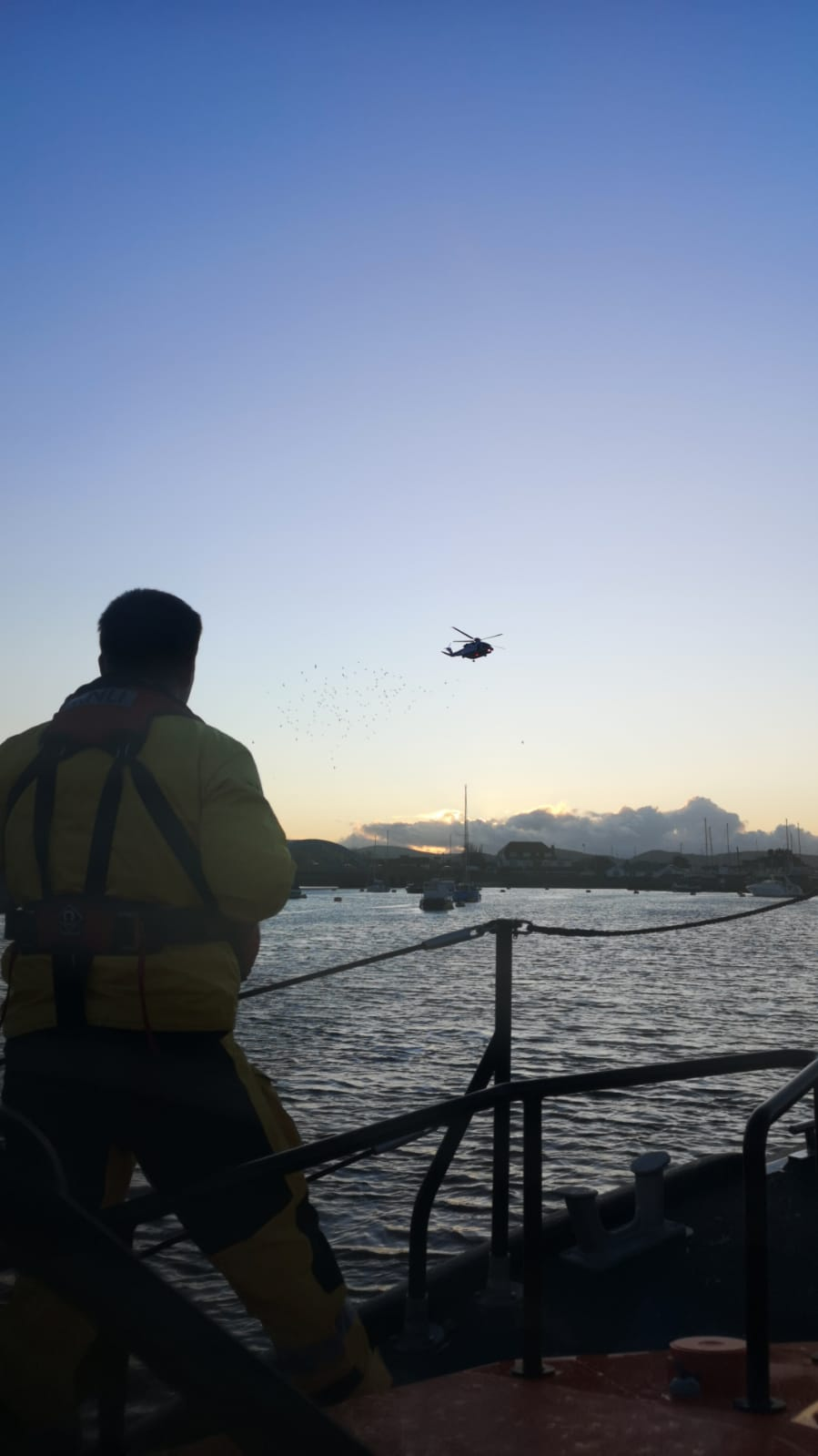 crew searching for missing person in harbour