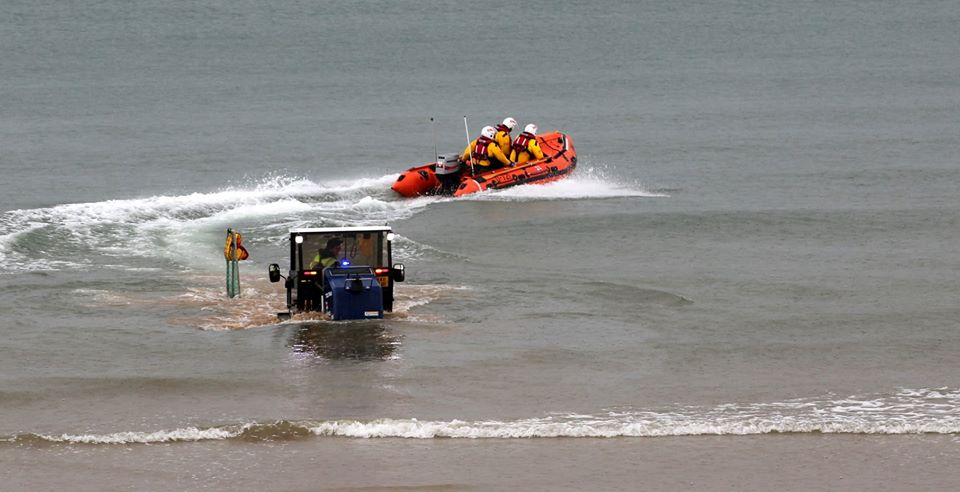 Bridlington RNLI's inshore lifeboat launches from the beach