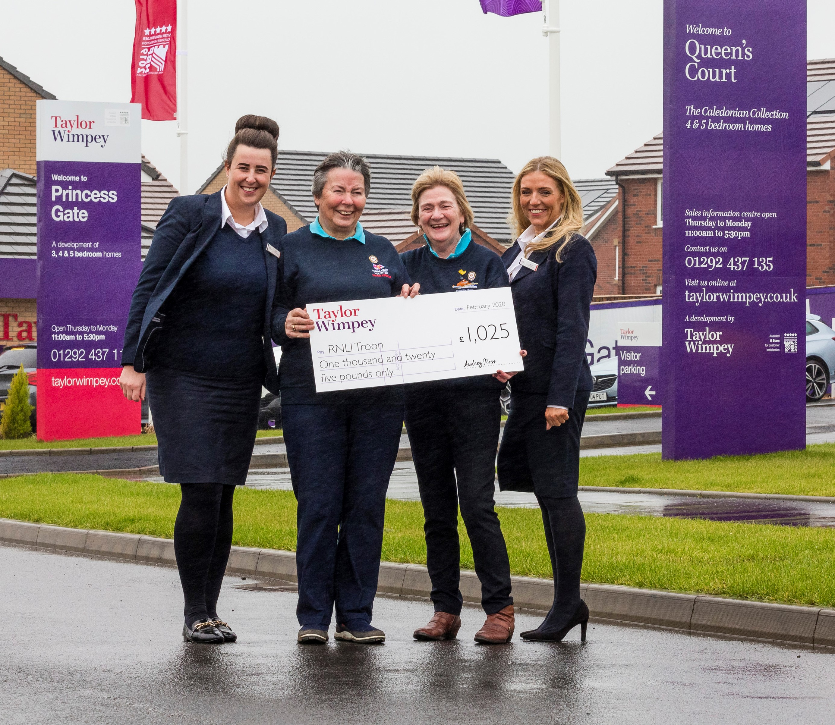 Taylor Wimpey Sales Executives in Troon - Claire Anderson and Nicola McLaughlin were on hand to present Margaret Ross and Urda Cotter from Troon RNLI with the cheque for £1025.