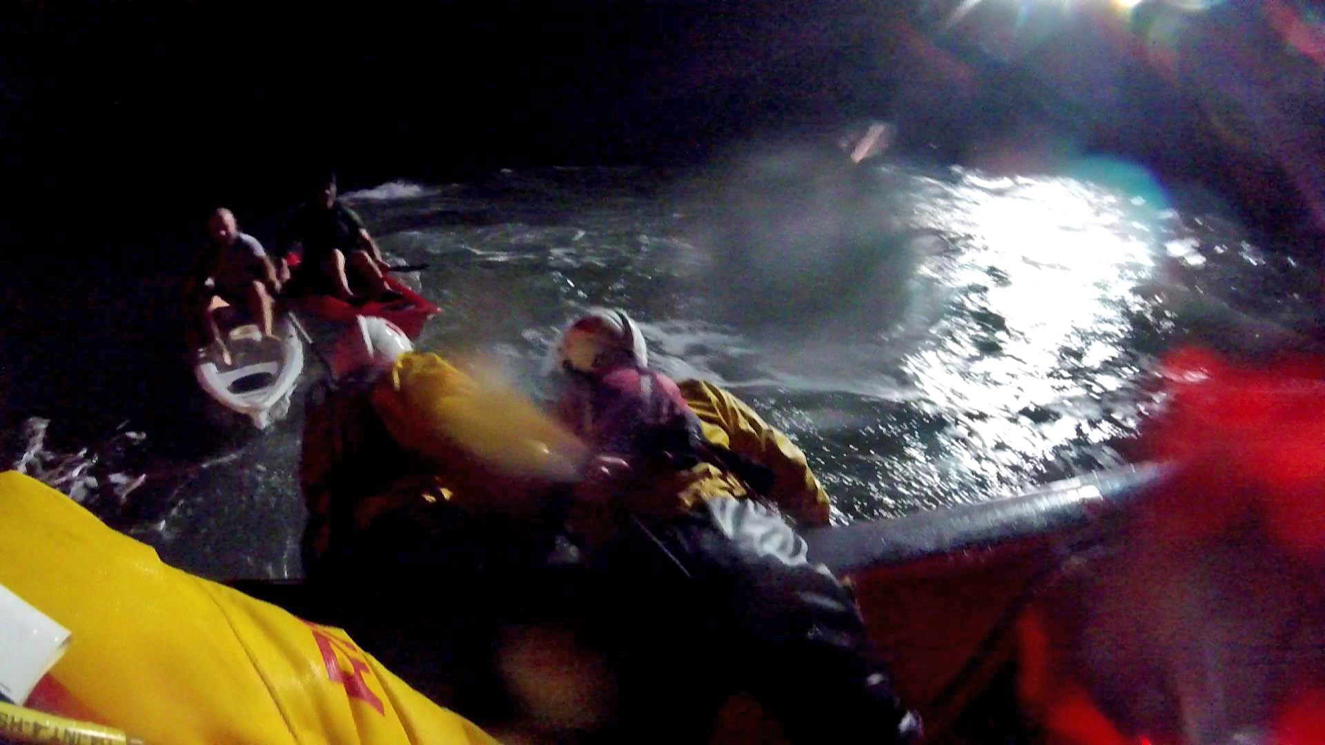 Two exhausted kayakers are found in the darkness by the RNLI lifeboat crew.