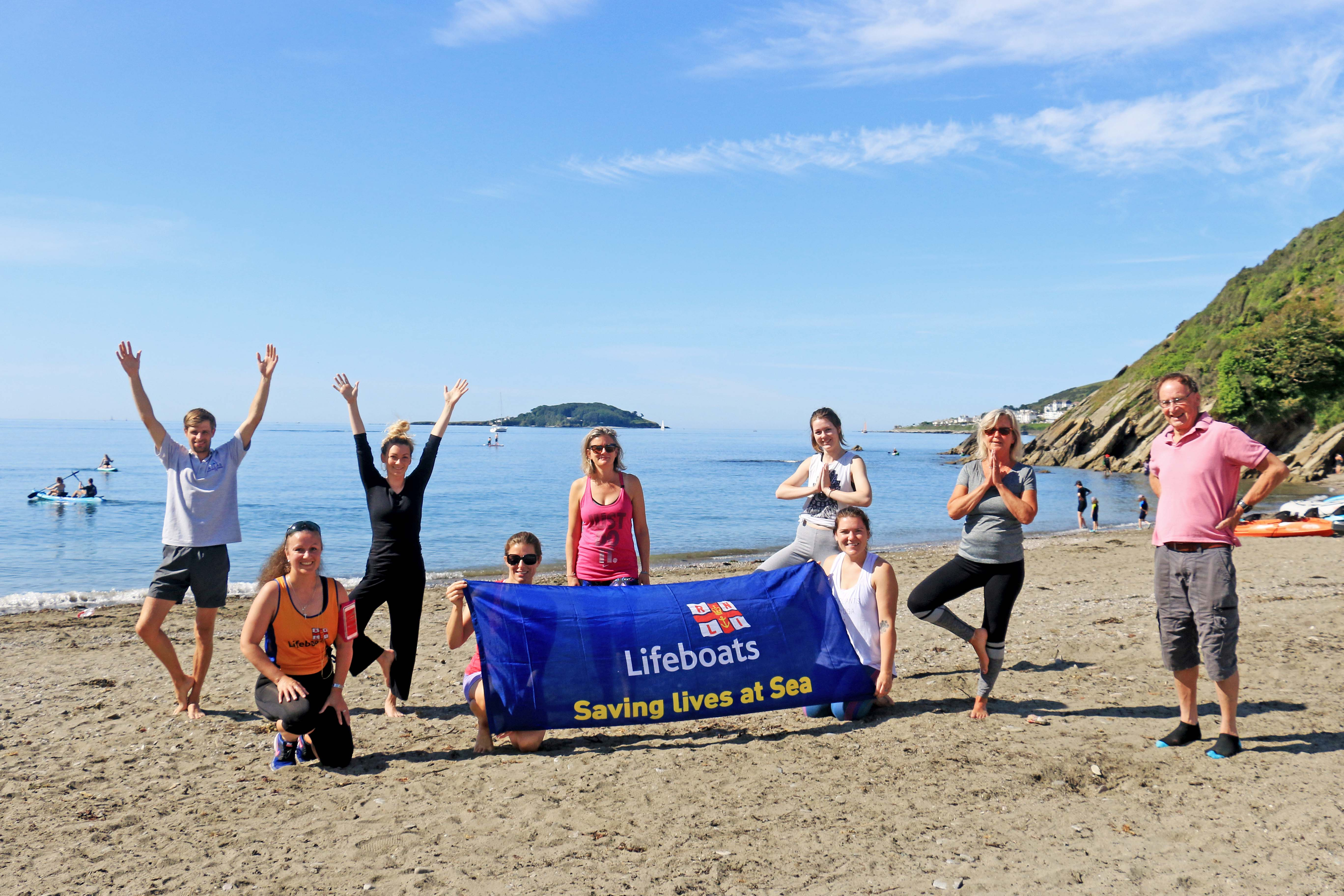 Yoga on the beach class at Millendreath, with Christina Hoppenbrouers and Looe RNLI volunteer crew member Victoria Thomas