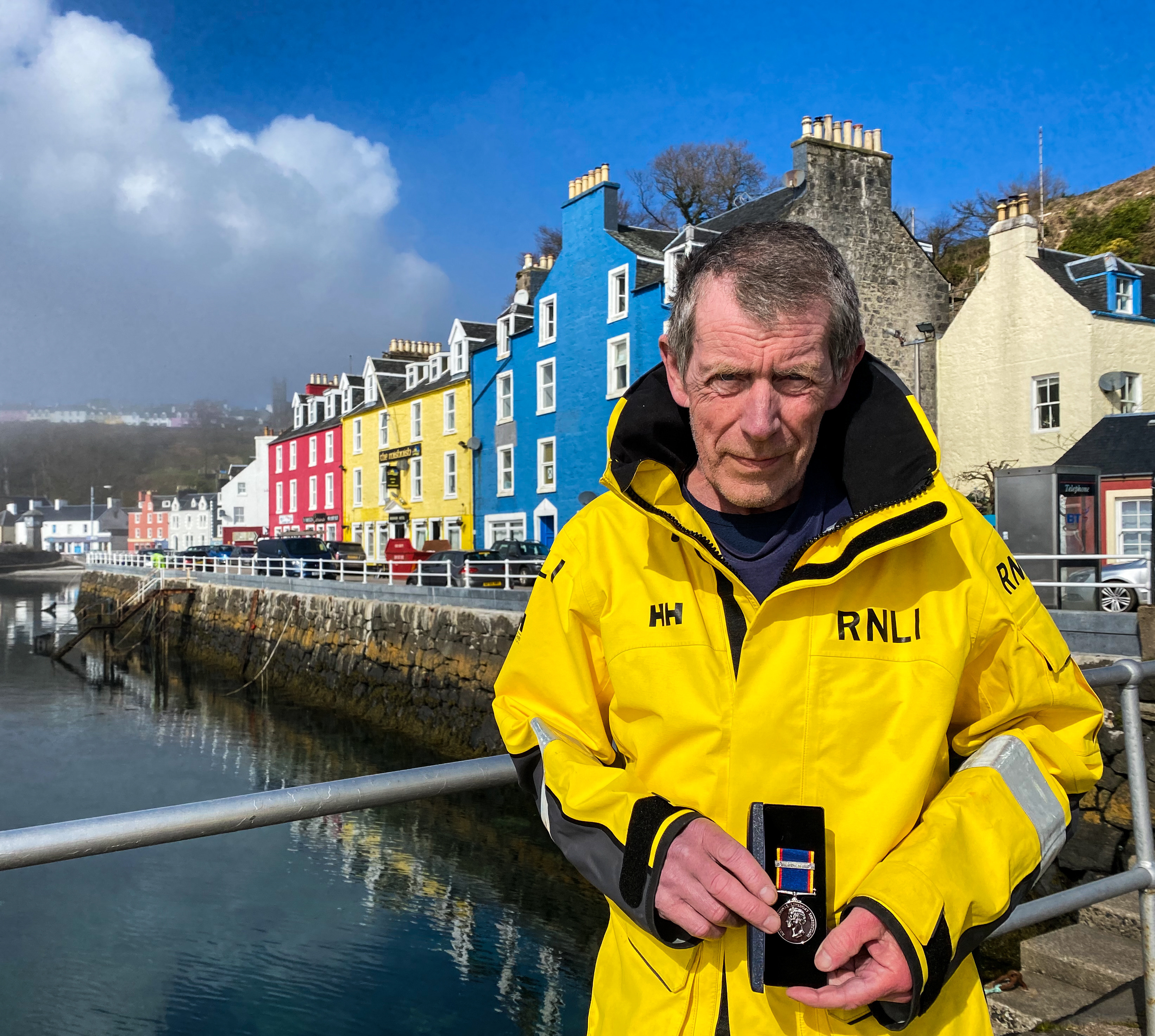 Tobermory RNLI Second Mechanic Creon Carmichael with 30 year long service medal
