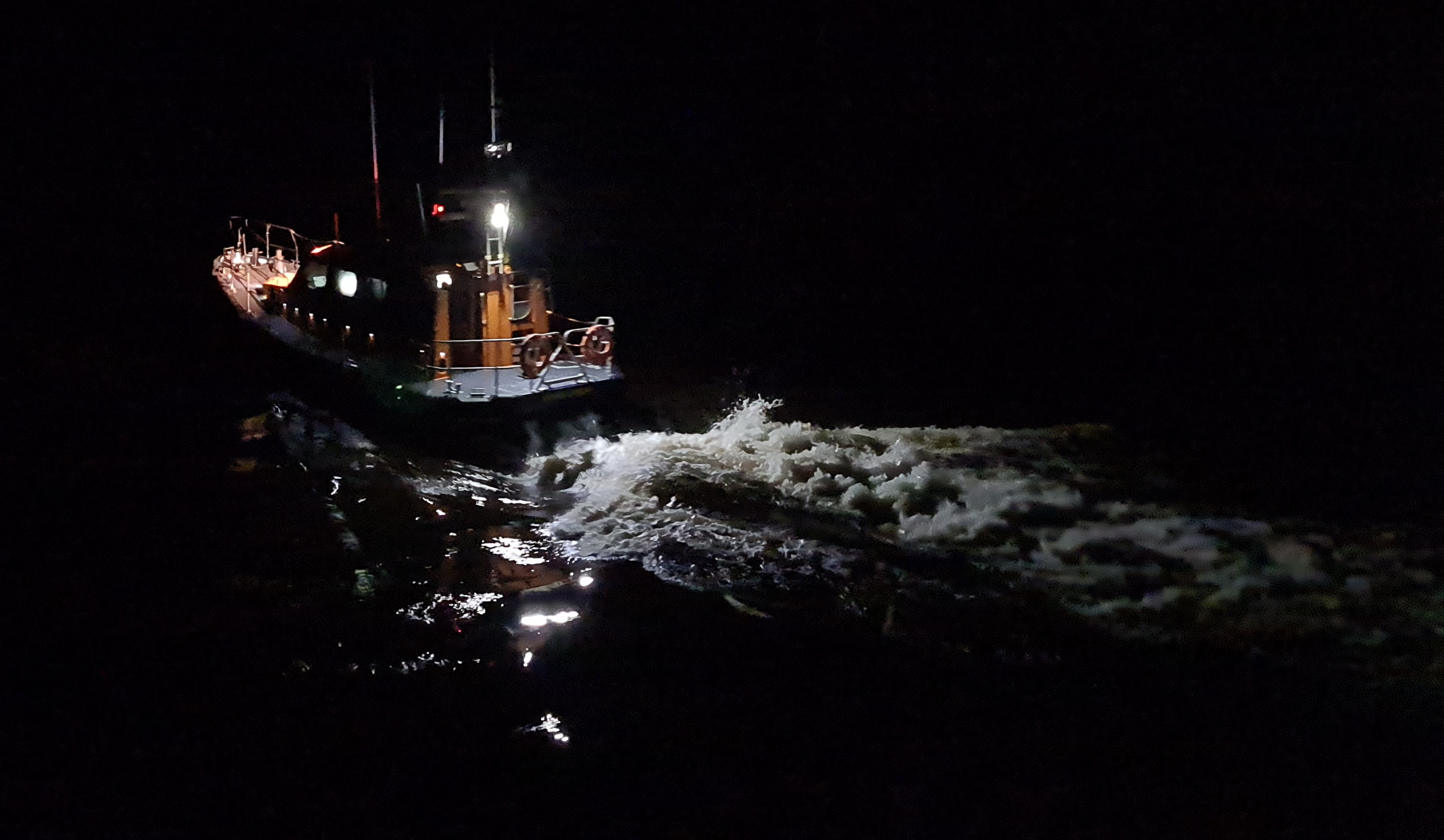 Shannon class all-weather lifeboat Elizabeth and Gertrude Allan launching in darkness to vessel aground