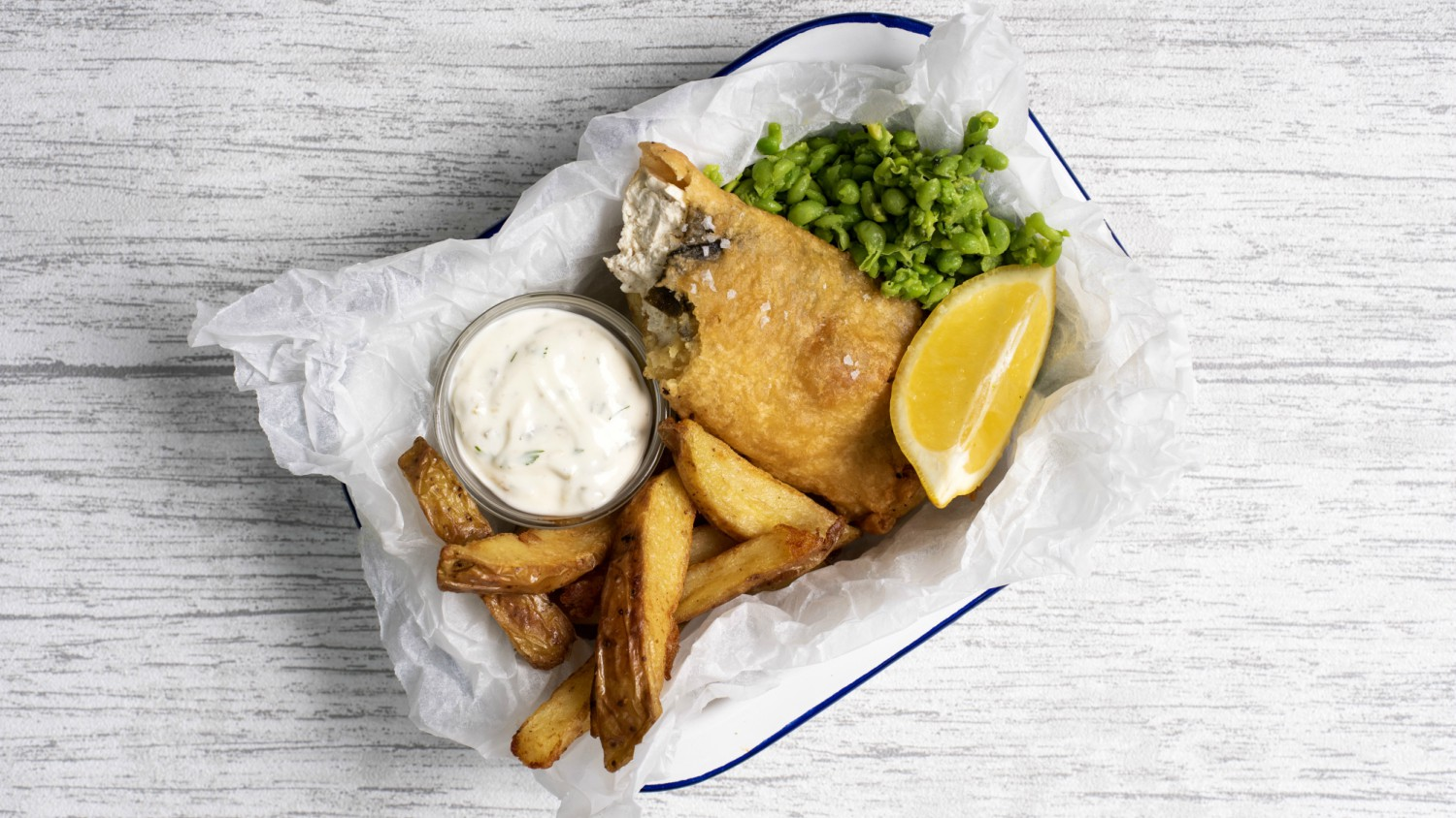 Beer battered tofu with chips and mushy peas