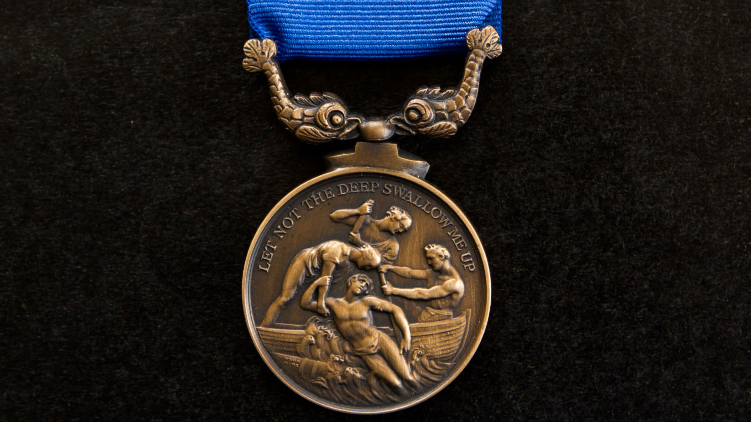 An RNLI Bronze Medal for Gallantry, engraved with the motto: 'let not the deep swallow me up', from Psalm 69:15