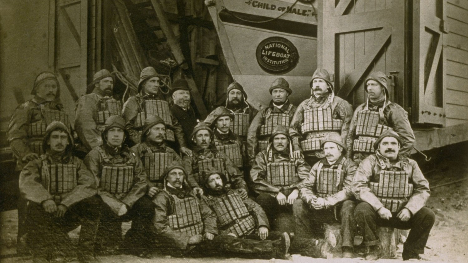 Crew of Fleetwood station wearing cork lifejackets and sou'westers circa 1890.