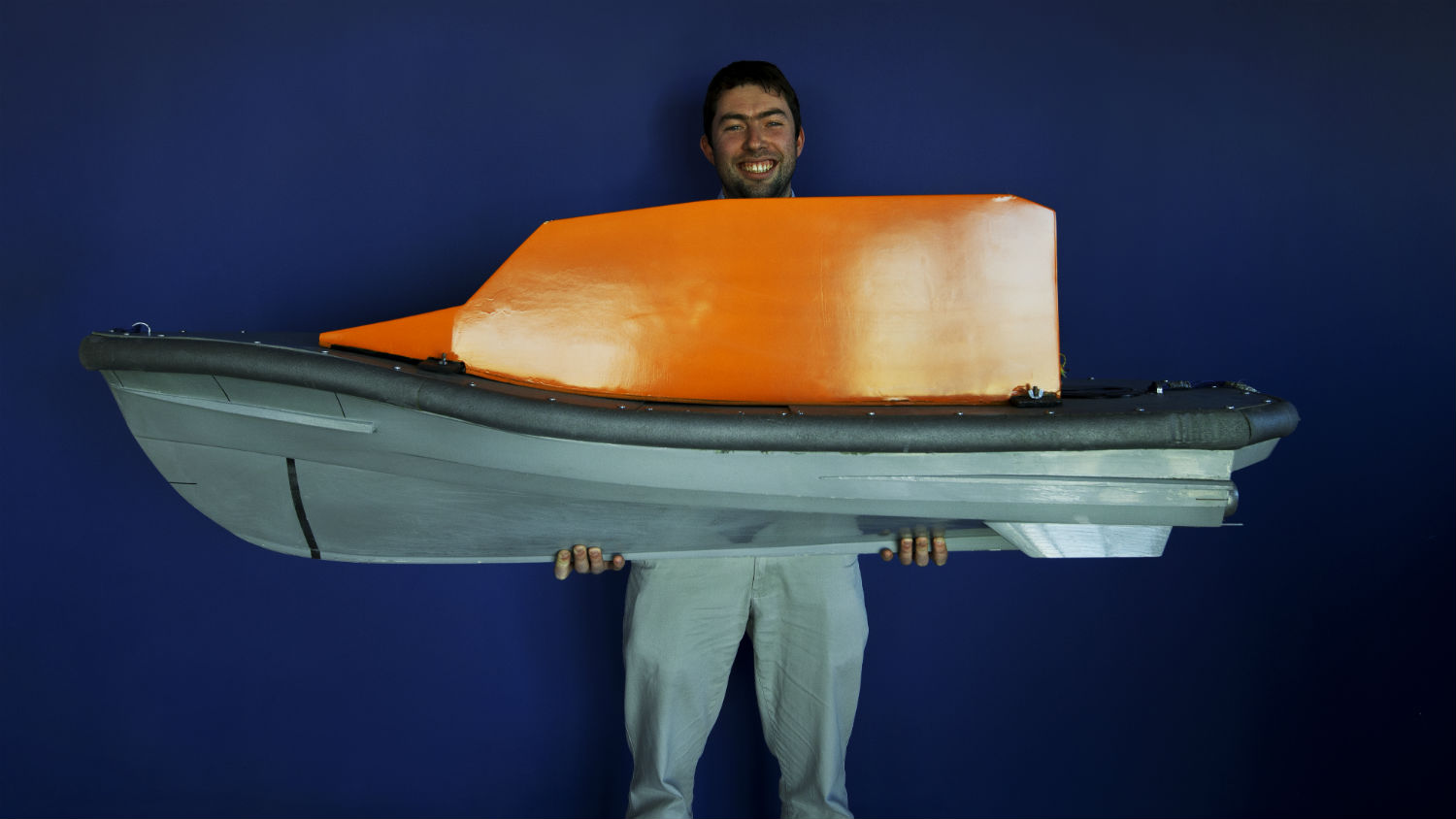 RNLI Naval Architect Peter Eyre with his hull model design for the new Shannon class lifeboat