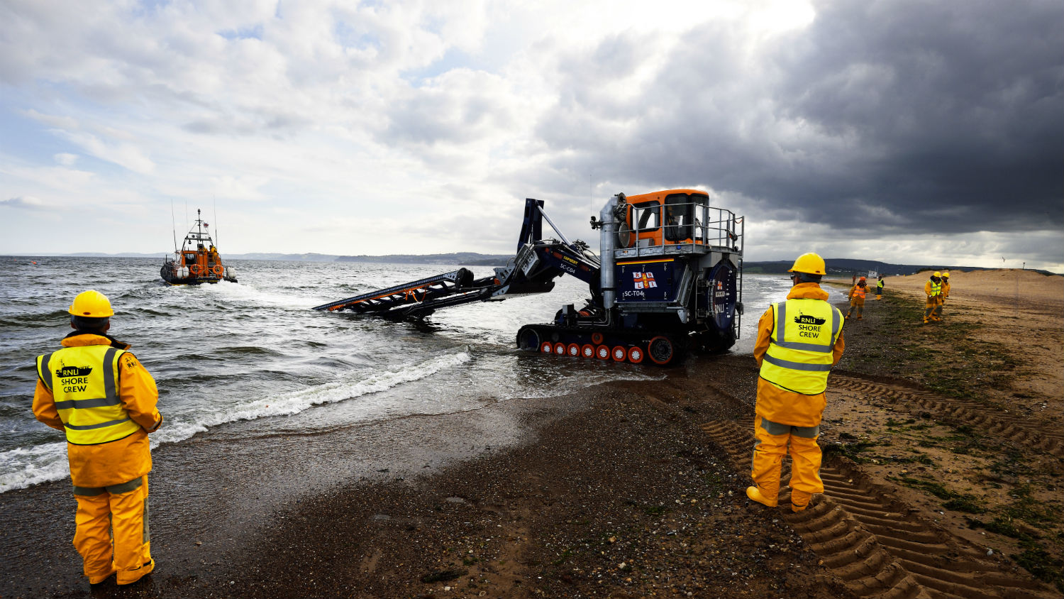Exmouth RNLI's Shannon class lifeboat, R and J Wellburn, being launched into the sea.