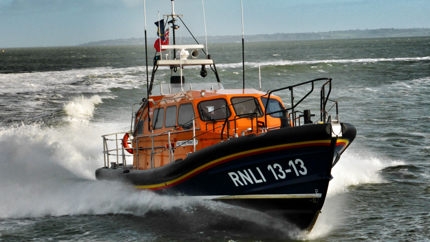 Swanage RNLI's Shannon class lifeboat, George Thomas Lacy 13-13, at sea.