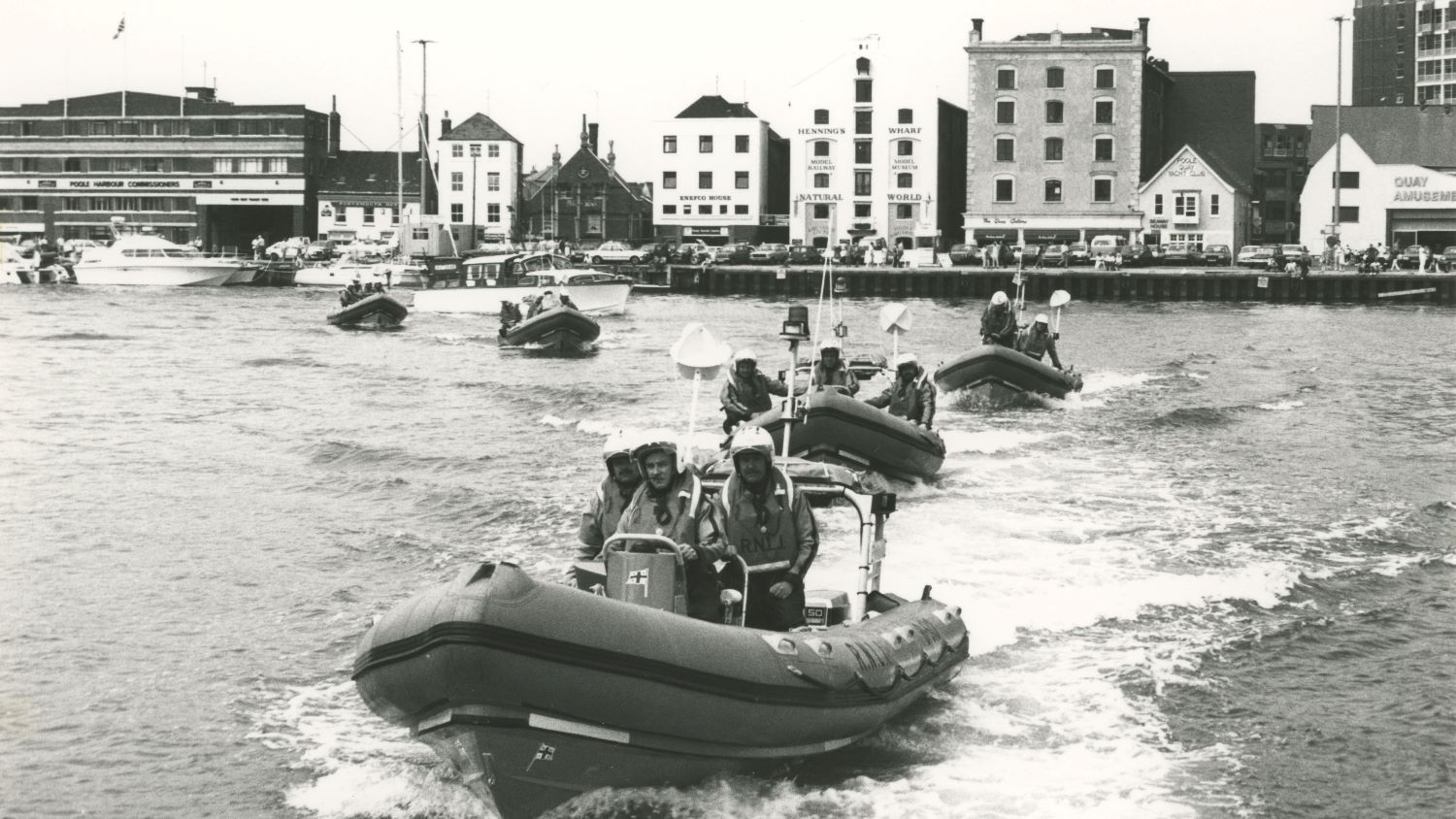 Black and white image of five inshore lifeboats