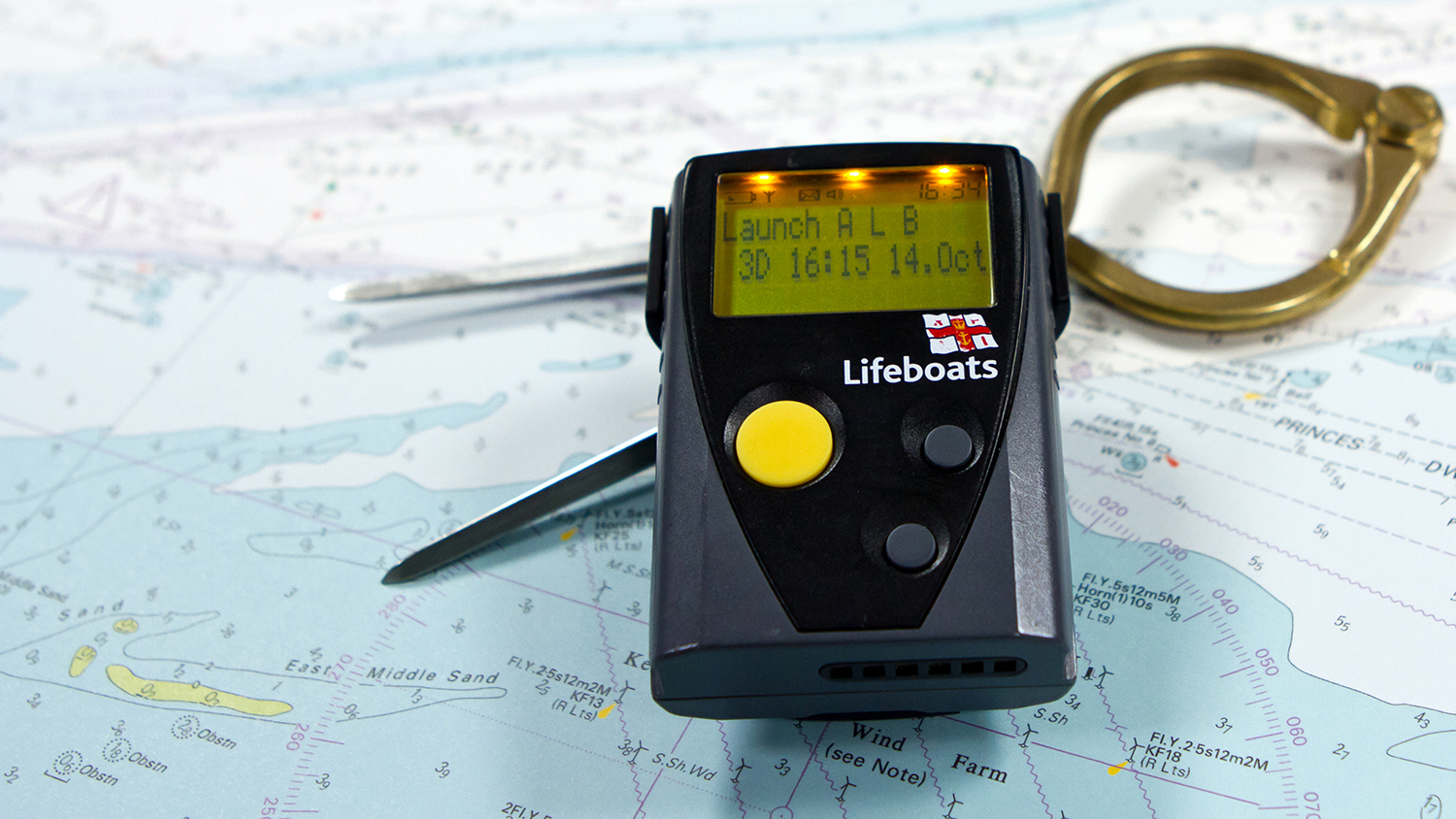 RNLI pager on a chart with a pair of dividers