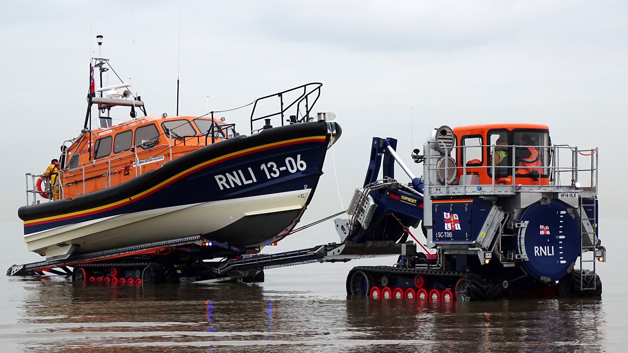 Hoylake's Shannon class lifeboat, Edmund Hawthorn Micklewood 13-06, being recovered by her launch and recovery tractor, Roland Hough