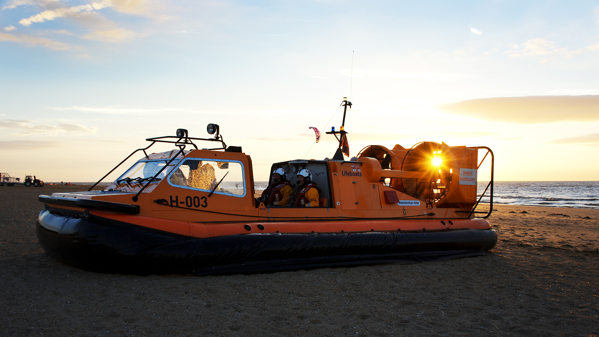 Hunstanton lifeboat volunteers onboard their rescue hovercraft, The Hunstanton Flyer H-003, at sunset