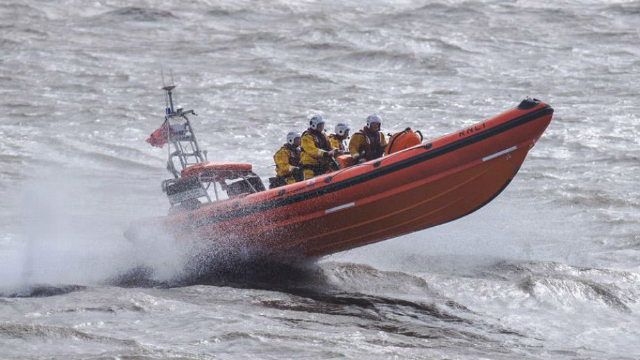 On the ropes: Tangled kitesurfer rescued by Porthcawl RNLI.