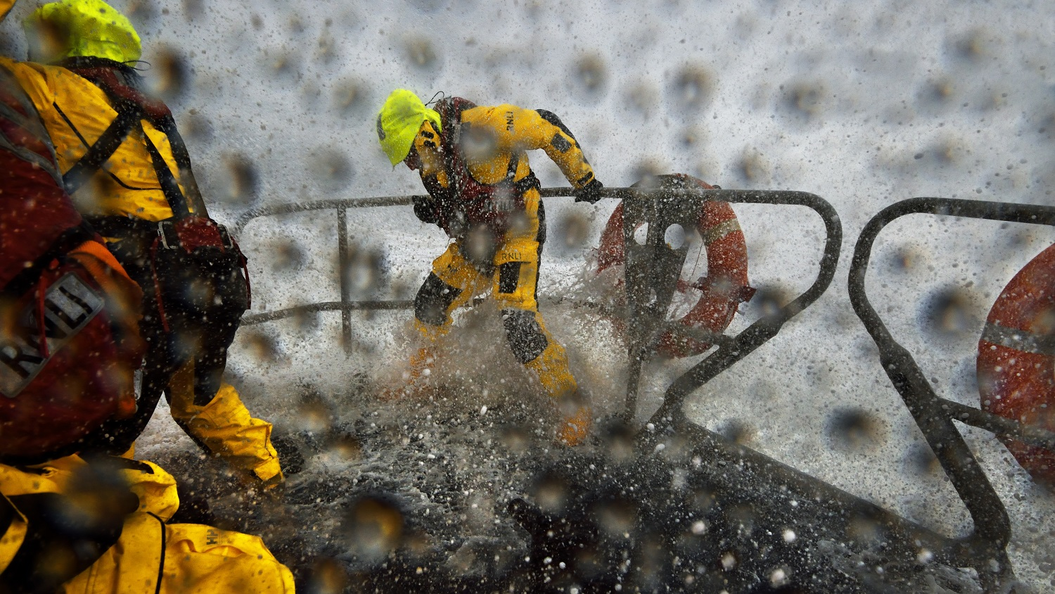 Crew members wearing new RNLI kit onboard Lowestoft Shannon class lifeboat in extremely rough weather and snow blizzards