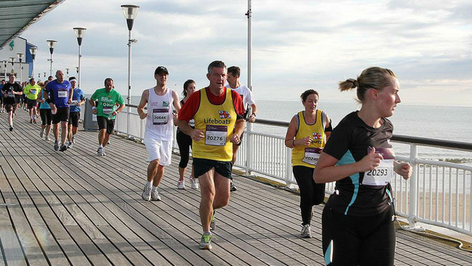 RNLI supporters running in a race along Bournemouth Pier