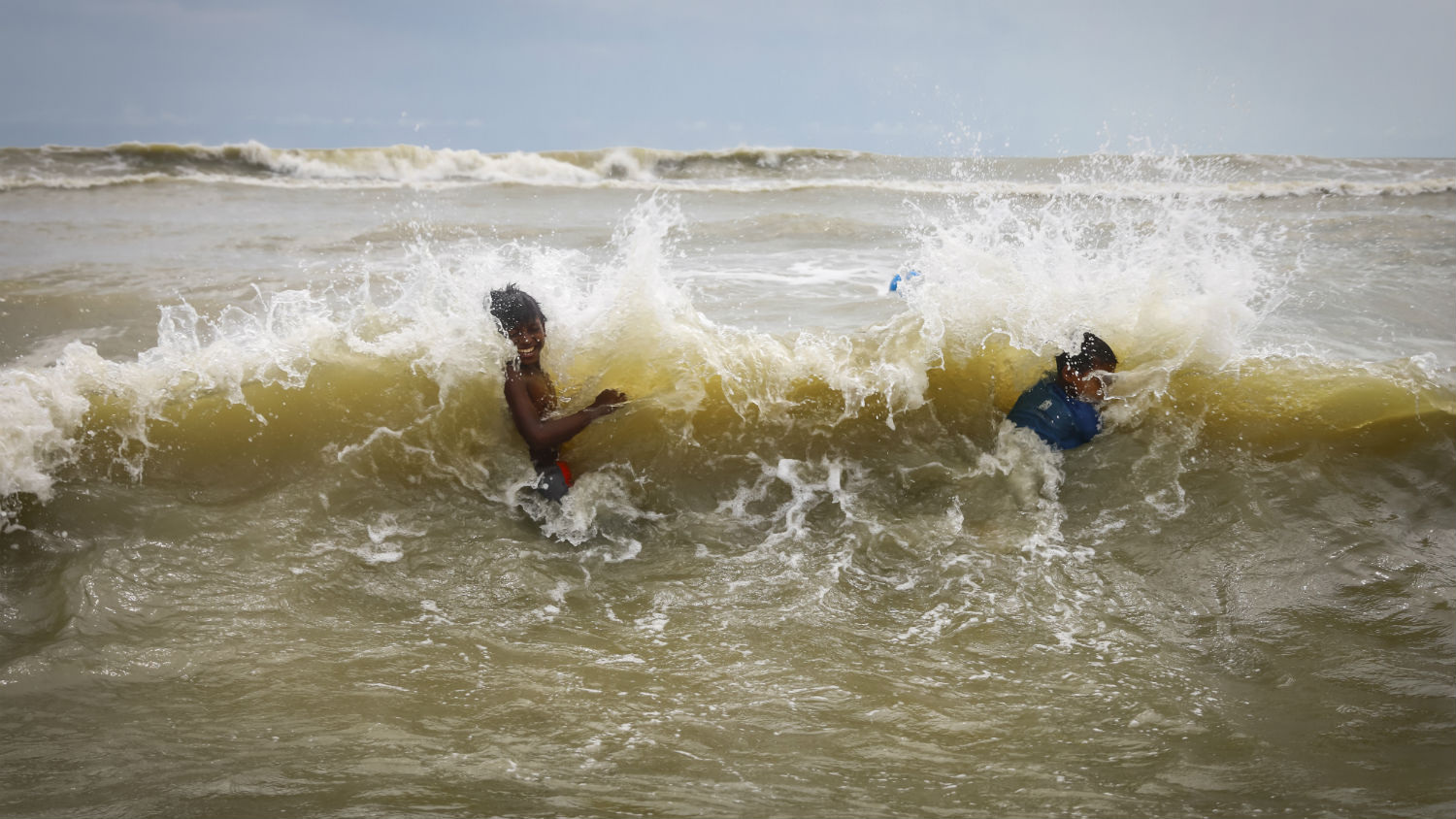 Local children swim in Cox's Bazar, Bangladesh