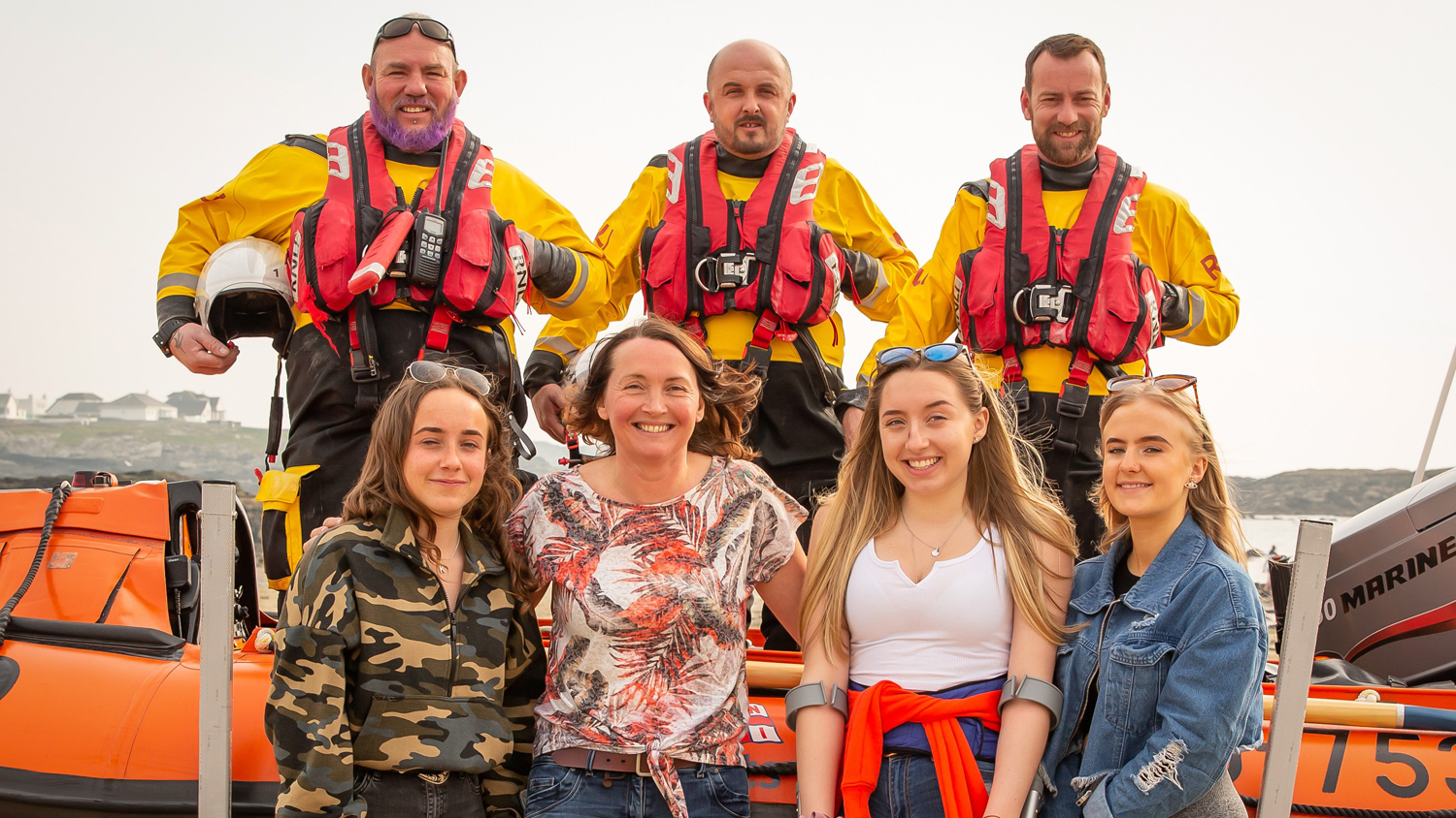 Kayakers Katie, Julie, Megan and Rachel with three of their Trearddur Bay RNLI rescuers - Helm Daf Griffiths and Crew Members Steve Williams and Tom Kearney