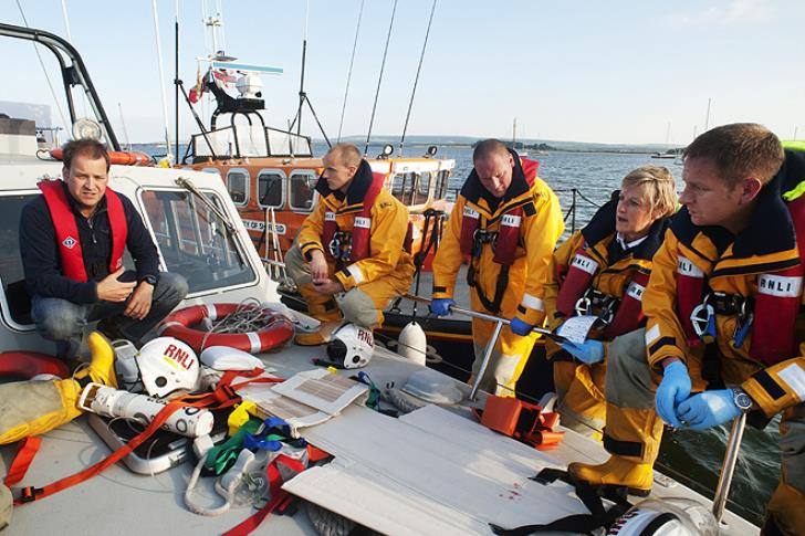 Paul Savage (left) is pictured with Poole lifeboat crew on a medical training exercise