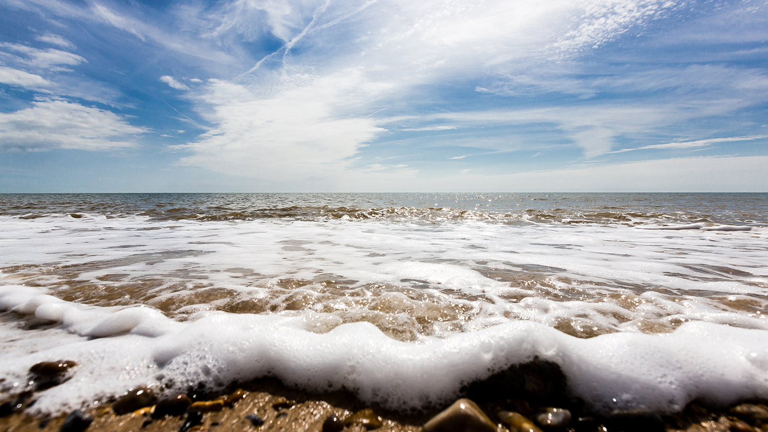Seascape shot of waves breaking on the shore at Aldeburgh
