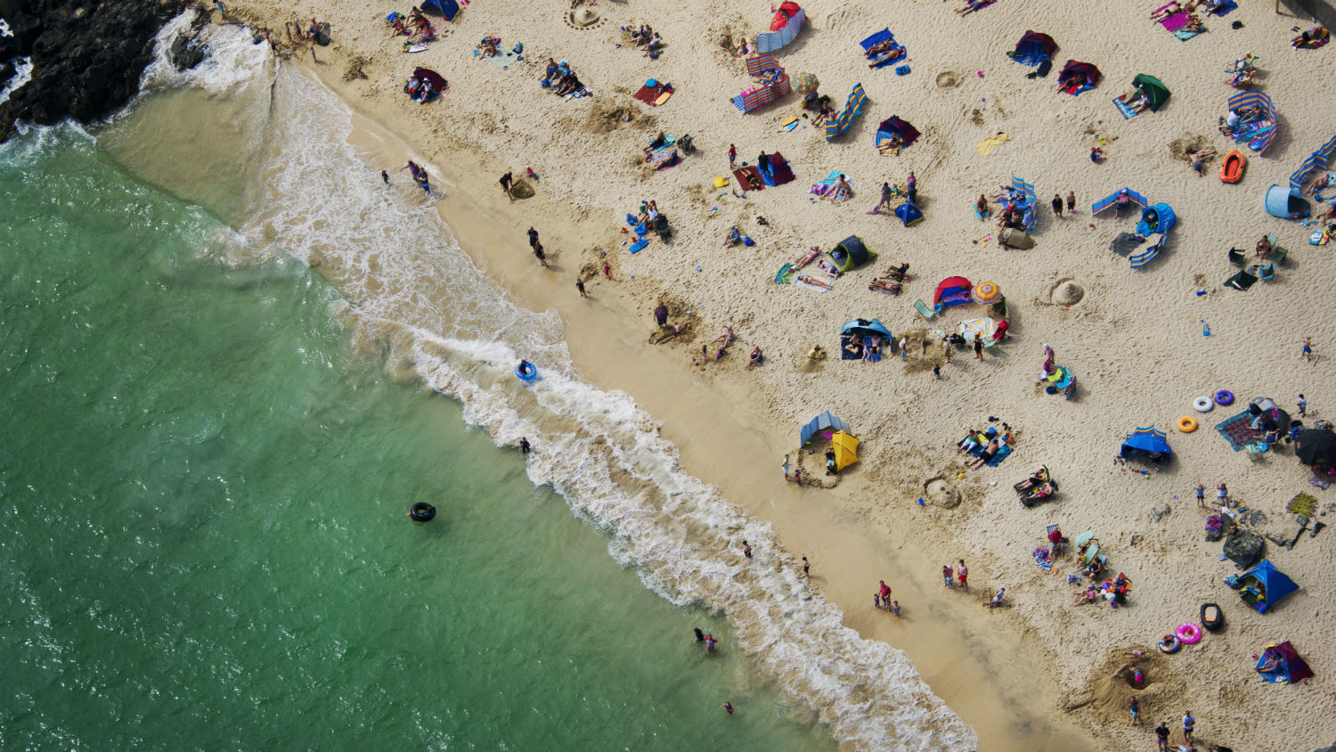 Aerial view of a busy beach on a sunny day
