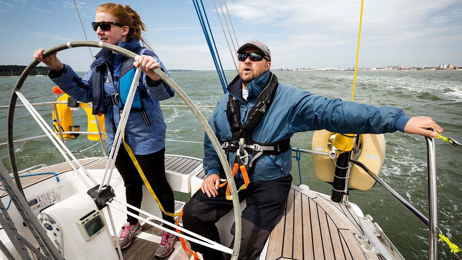 Yacht sailing: Crew at the helm