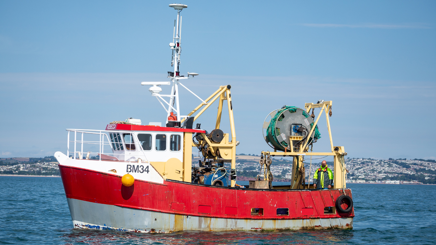 A commercial fishing vessel with an A-frame