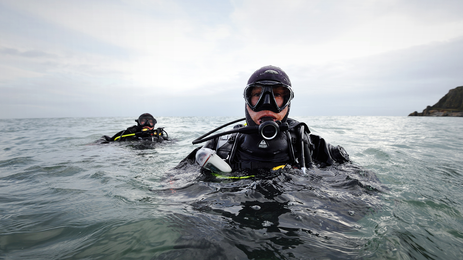Divers in the sea during a search and rescue exercise with RNLI Torbay.