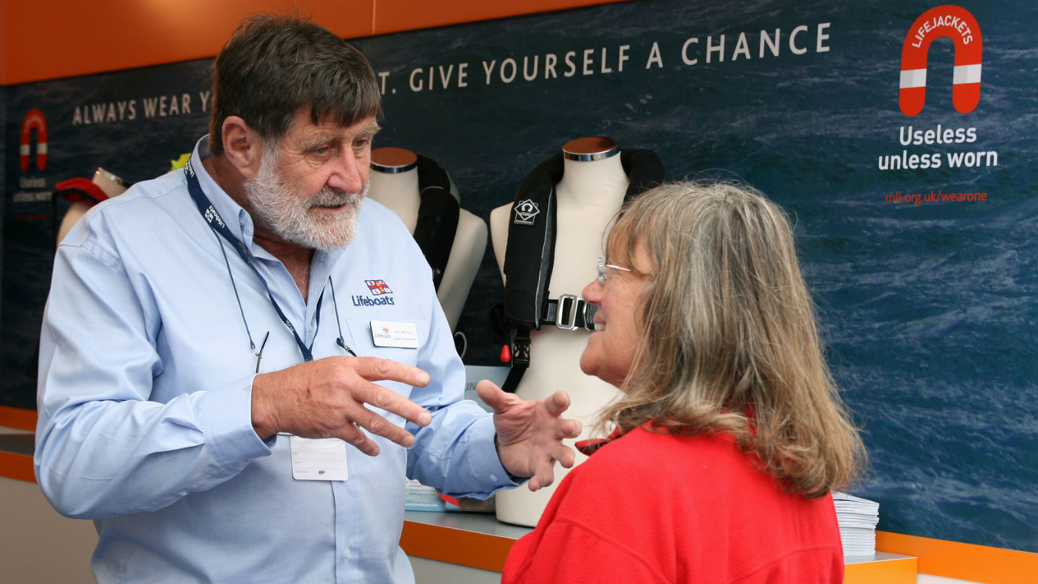 RNLI Community Safety Volunteer Bill Walton giving advice at Southampton Boat Show