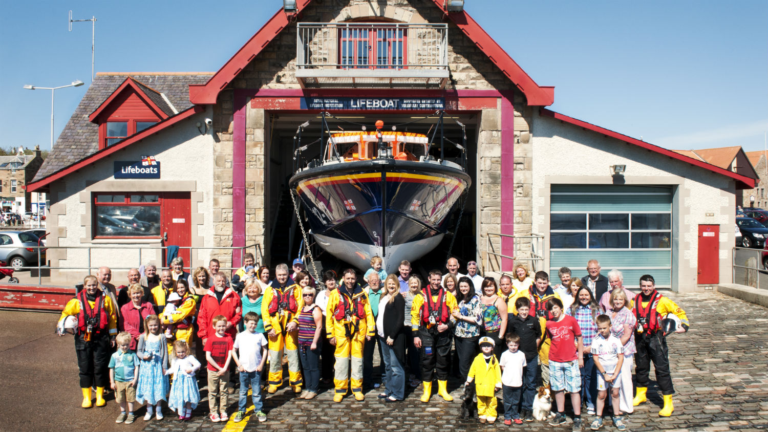 A group shot of Anstruther RNLI volunteers with their supporting families and community