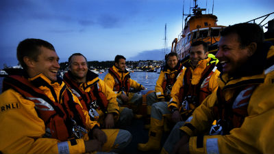 St Peter Port RNLI lifeboat crew onboard their boarding boat after a successful shout