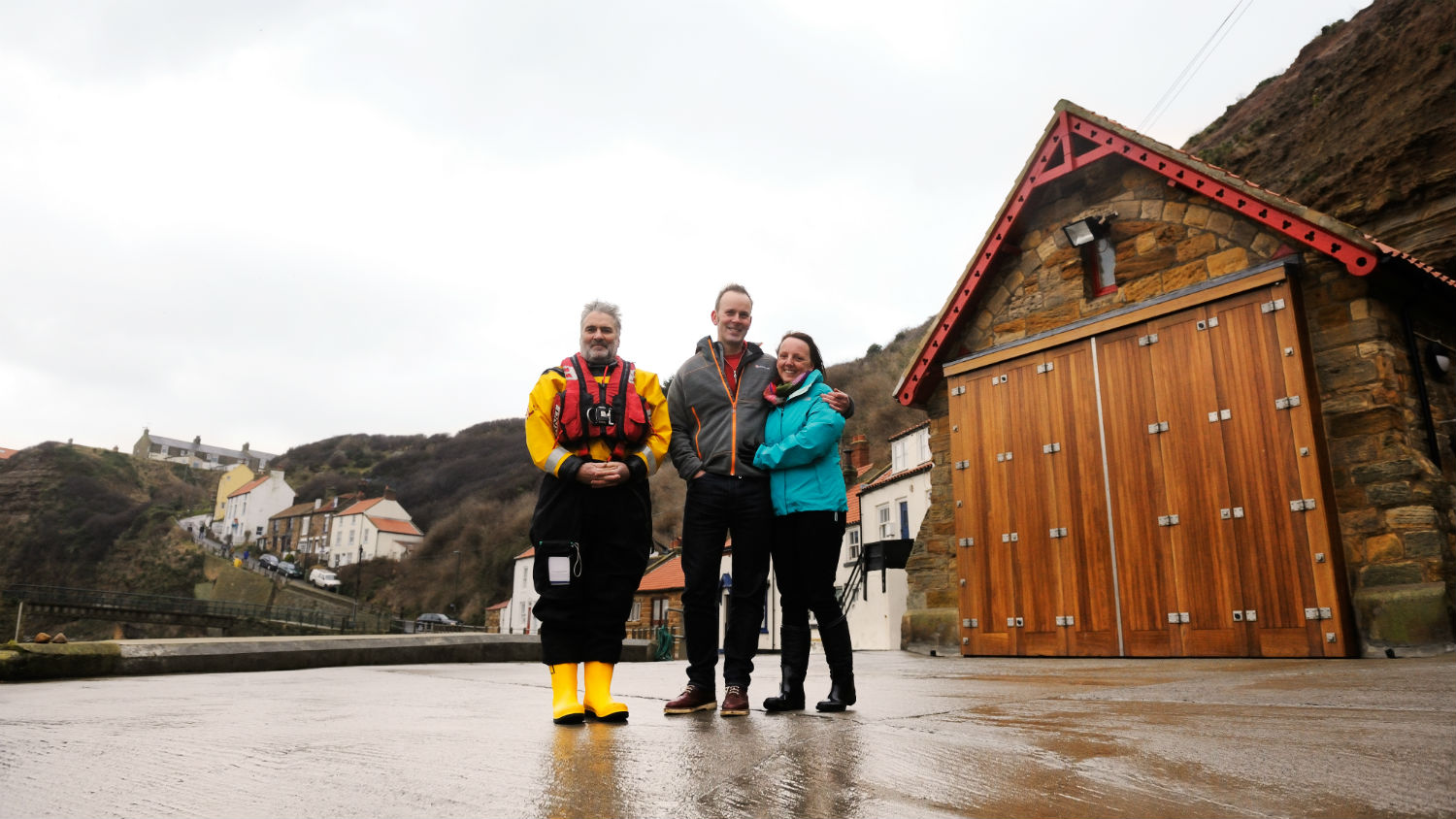 Louisa Barrow and Peter Severs with one of their rescuers, Sean Baxter, at Staithes and Runswick Lifeboat Station