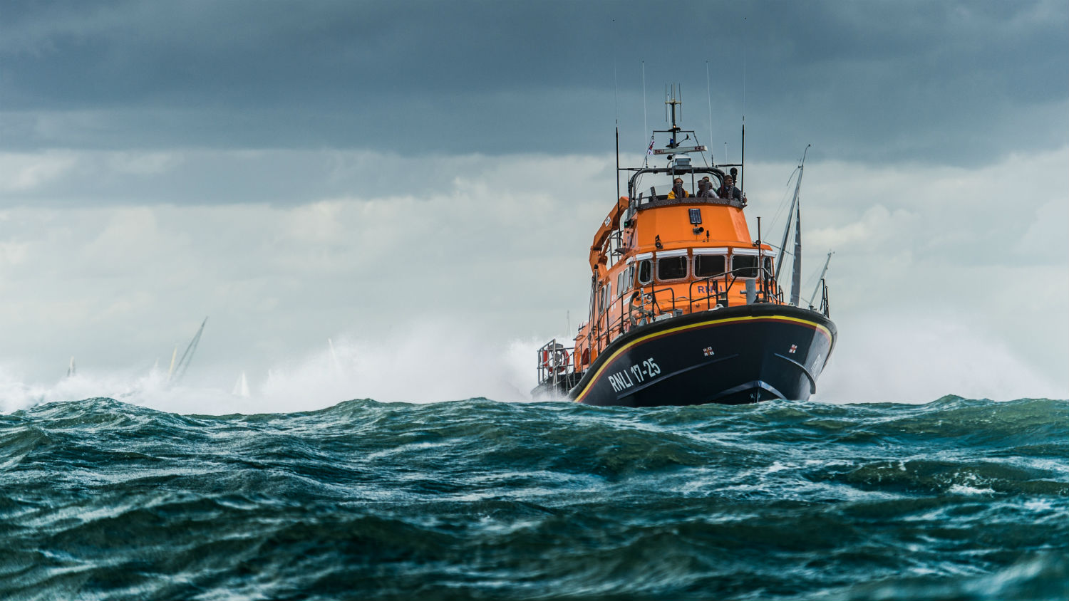 Yarmouth RNLI's Severn class lifeboat, Eric and Susan Hiscock (Wanderer) 17-25, providing safety cover during the 2016 Round the Island Race