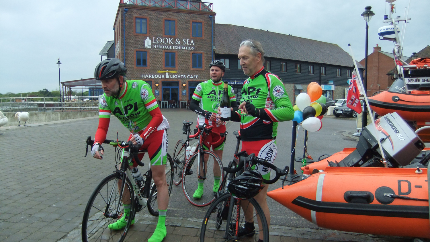 Cyclists arrive at the finish at Littlehampton Lifeboat Station