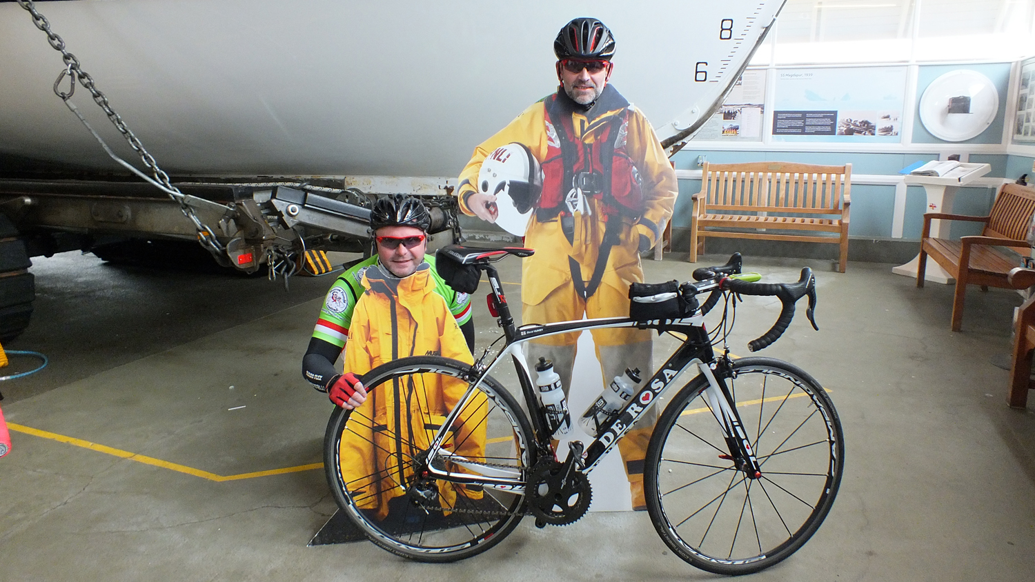 Two of the cyclists having fun at the start at Aldeburgh Lifeboat Station