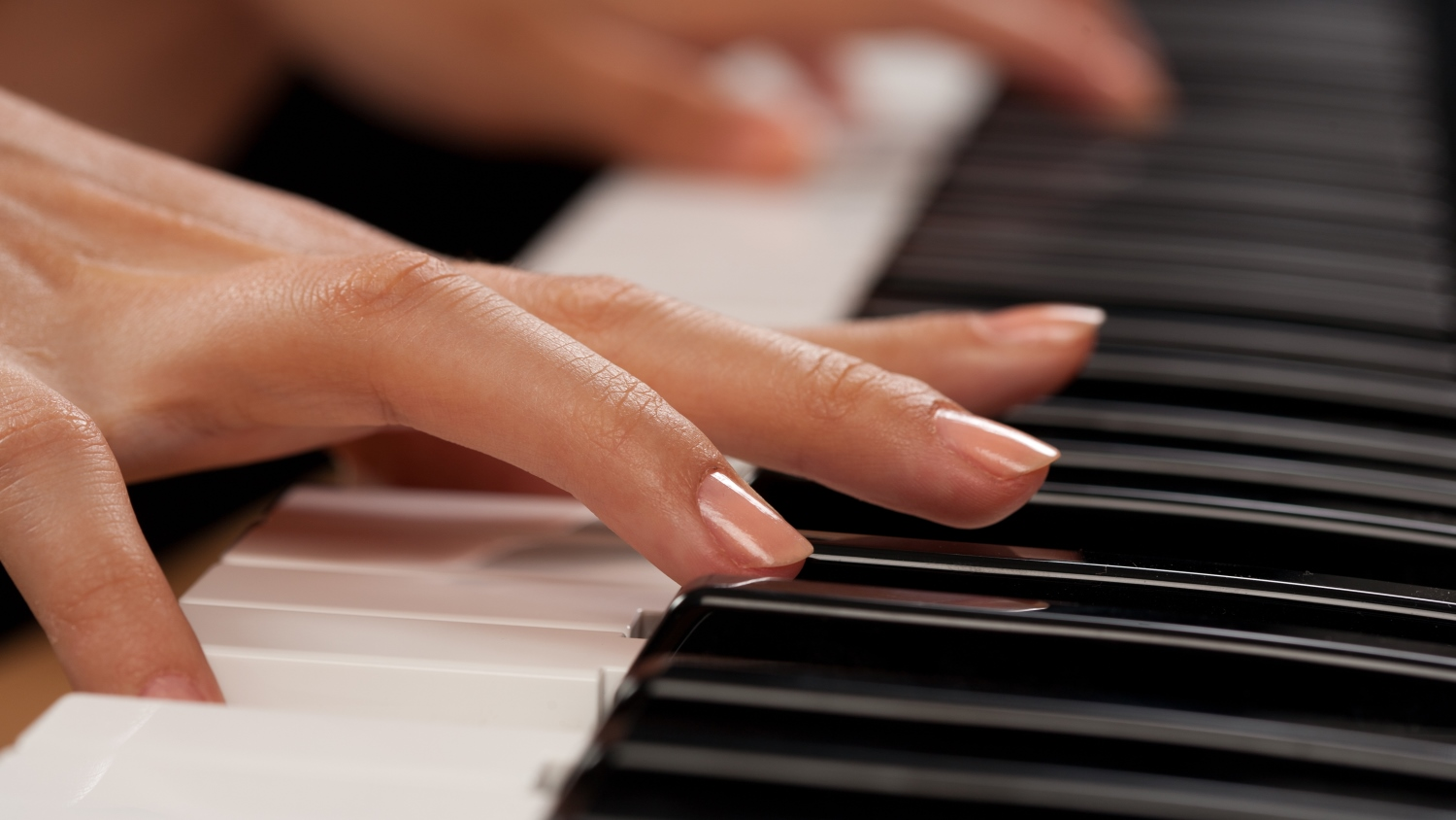 Woman's hands playing the piano