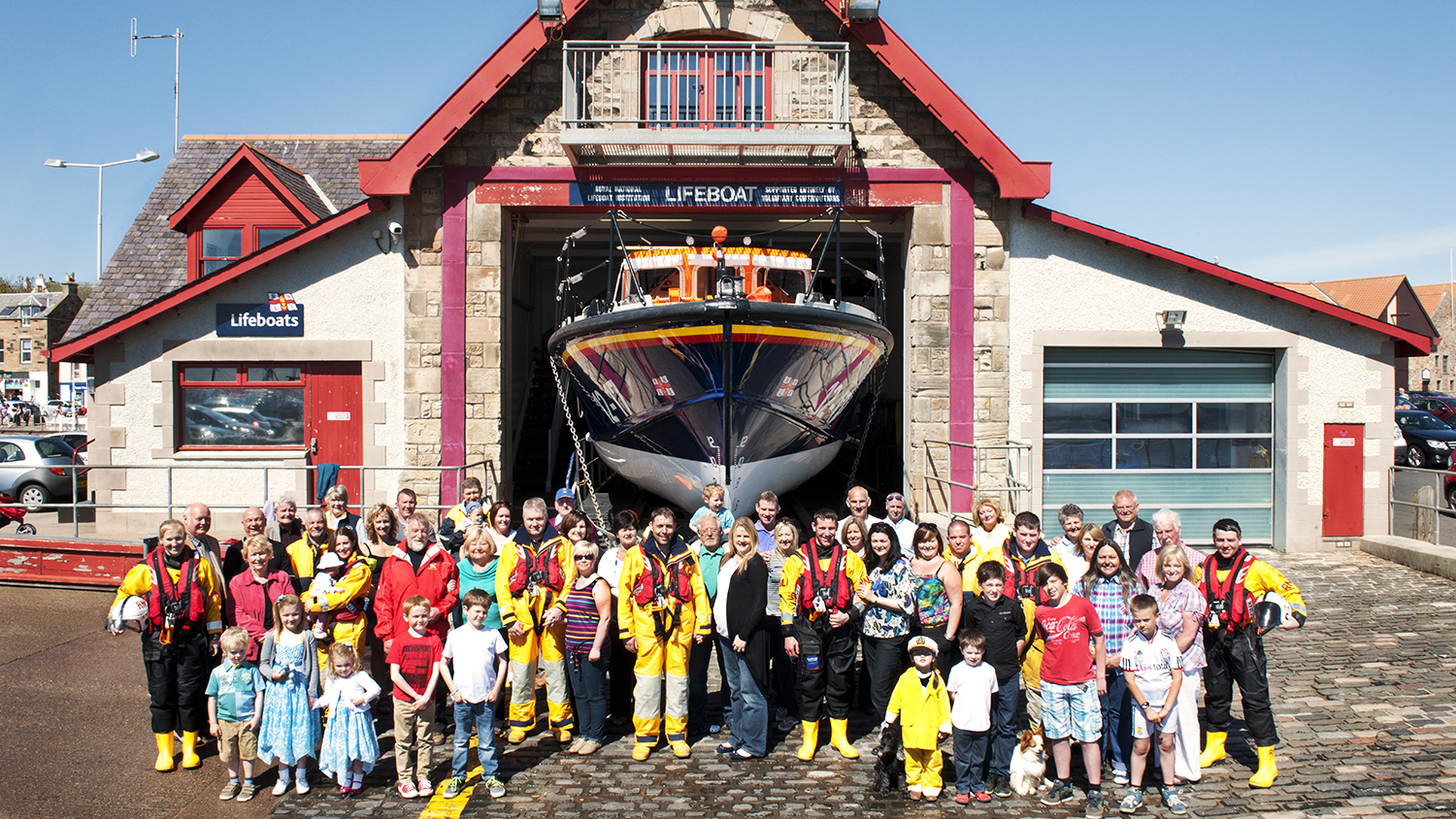 A group shot of Anstruther lifeboat volunteers with their supporting families and community