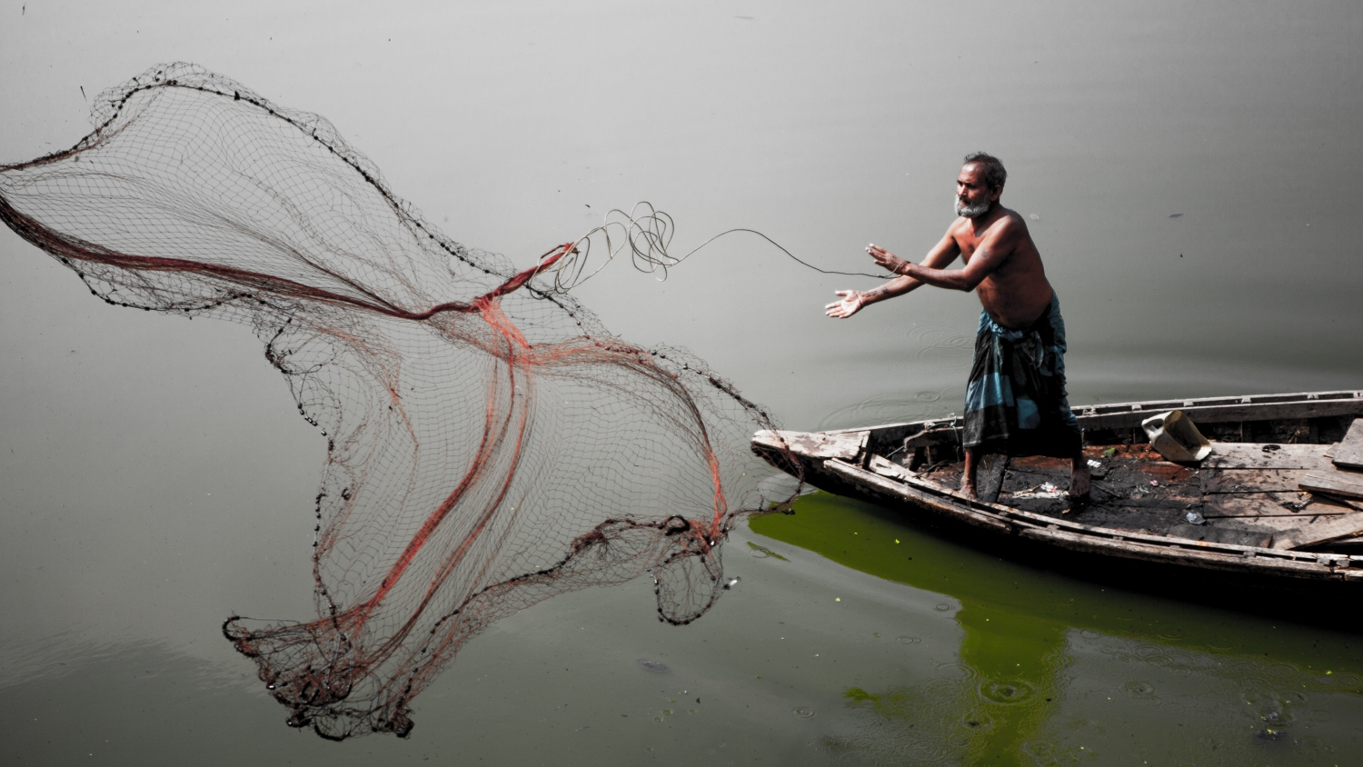 A fisherman on a river in Bangaldesh