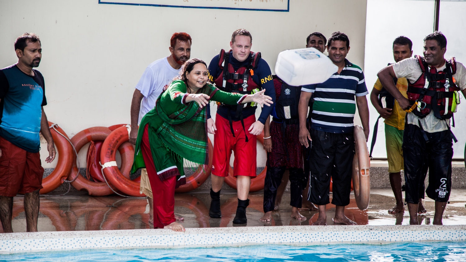 Flood rescue trainees in a swimming pool in Bangladesh