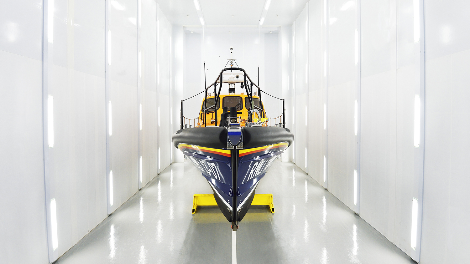 Relief Shannon class lifeboat, Reg 13-07, inside a spray booth at our All-weather Lifeboat Centre