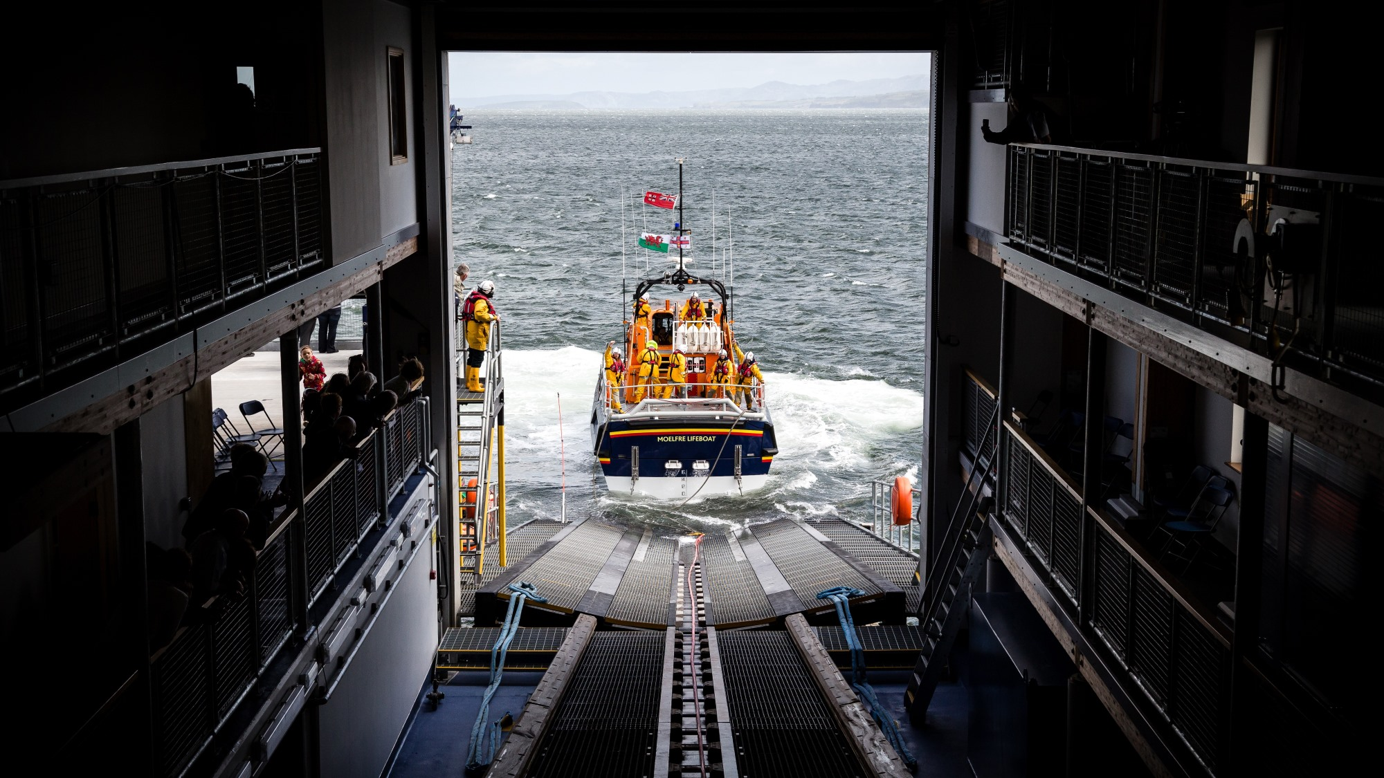 View from inside Moelfre Lifeboat Station of the station's Tamar class lifeboat, Kiwi 16-25, being recovered up the slipway