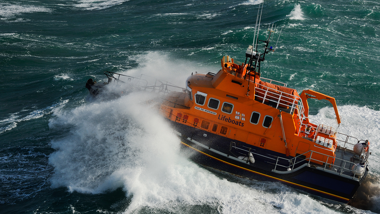 St Mary's Severn class lifeboat powering through the waves