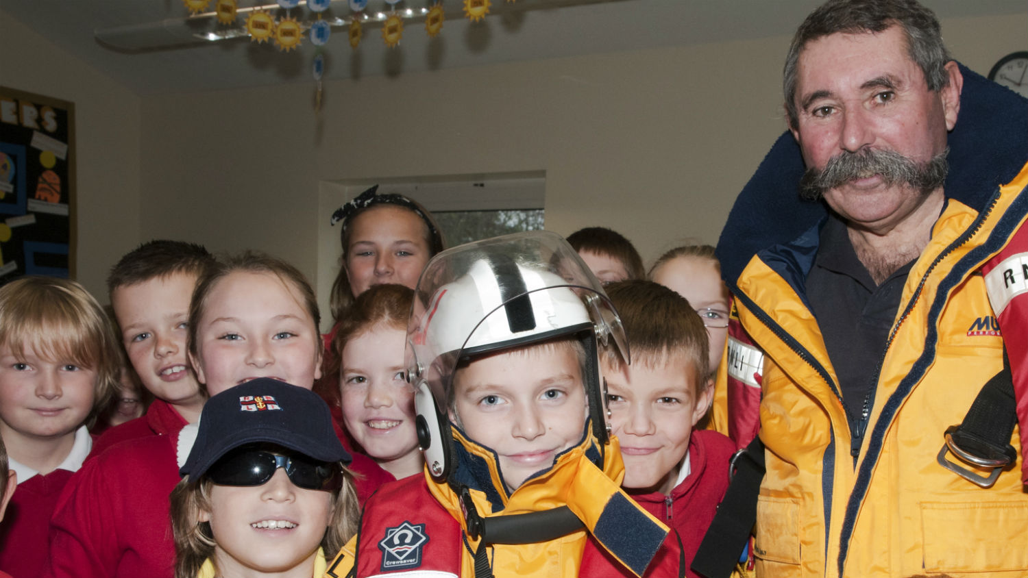 RNLI education presenter Jon Yabbesley with pupils at Pucklechurch Primary School in Bristol.